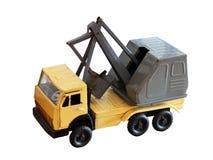 Модель игрушки трактора корабля машины конструкции изолировала белую предпосылку, ретро Стоковая Фотография