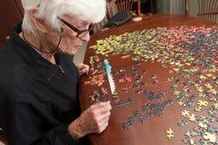 Мозаика положенная совместно женщиной eldery Стоковое Изображение RF