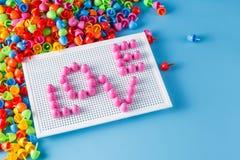 Мозаика ребенк с влюбленностью слова Стоковые Фото