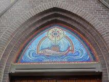 Мозаика рыб над дверью церков Стоковая Фотография