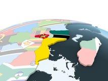 Мозамбик с флагом на глобусе иллюстрация штока