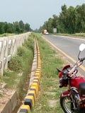 Мой мотоцикл на стороне mardan дороги Стоковое фото RF
