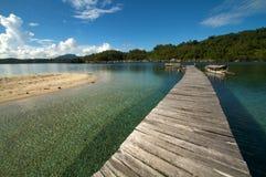мола пляжа над тропическое деревянным Стоковая Фотография