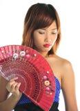 Молодая азиатская женщина с вентилятором Стоковая Фотография RF