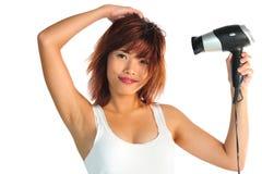 Молодая азиатская женщина с волос-сушильщиком Стоковое фото RF