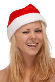 Молодая белокурая женщина в подмигивать шлема santa Стоковое фото RF