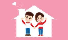 Молодая восточная пара с костюмом зимы и предпосылкой дома стоковые фотографии rf