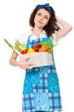 Молодая домохозяйка на белизне Стоковая Фотография RF