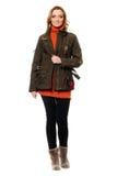 Молодая женщина в куртке и свитере стоковое фото rf