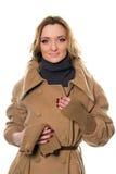 Молодая женщина в пальто стоковое изображение