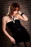 Молодая женщина в черном платье Стоковое Изображение