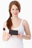 Молодая женщина подготовила для прикладывать состав стоковое фото rf