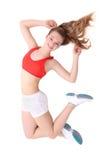Молодая женщина пригодности скача над белизной стоковое фото rf