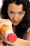Молодая женщина при большая изолированная резина истирателя карандаша Стоковое фото RF