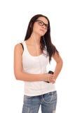Молодая женщина слушает нот Стоковое фото RF