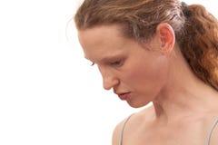 Молодая женщина смотря вниз Стоковое Изображение