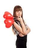 Молодая женщина с воздушными шарами формы сердца стоковое фото rf