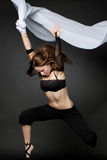 Молодая красивейшая женщина скача на черноту Стоковые Фотографии RF