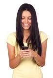 Молодая милая женщина используя мобильный телефон стоковая фотография rf