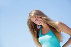 Молодая счастливая женщина над голубым небом Стоковое Изображение