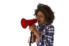 Молодой афроамериканец используя мегафон стоковые фото