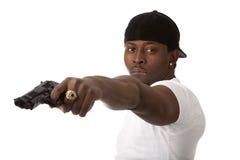 Молодой бандит с пушкой Стоковые Изображения RF
