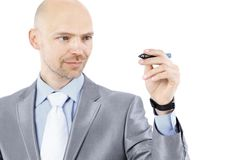 Молодой бизнесмен делает показатель Стоковые Изображения