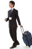Молодой бизнесмен на командировке Стоковые Изображения