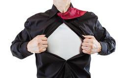 Молодой бизнесмен показывая костюм супергероя стоковые изображения