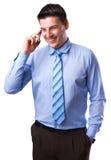 Молодой бизнесмен с мобильным телефоном Стоковая Фотография
