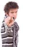 Молодой вскользь человек указывая с его перстом стоковое фото rf