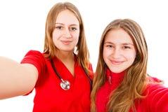 Молодой женский доктор и ее сестра Стоковые Изображения RF