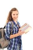 Молодой женский студент изолированный на белизне Стоковая Фотография