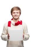 Молодой жизнерадостный счастливый знак удерживания человека Стоковое Фото