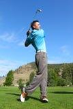 Молодой игрок в гольф стоковое фото