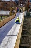 Молодой мальчик на скольжении льда Стоковые Изображения