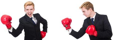 Молодой работник с перчатками бокса изолированными на белизне стоковое фото