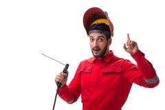 Молодой ремонтник с электродом оружия заварки и isolat шлема Стоковые Изображения
