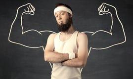 Молодой слабый человек с вычерченными мышцами Стоковые Изображения RF