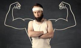 Молодой слабый человек с вычерченными мышцами Стоковые Фотографии RF