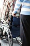 Молодой человек в кресло-коляске Стоковая Фотография