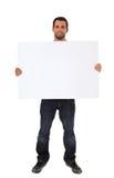 Молодой человек держа пустой белый знак Стоковое фото RF