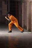 Молодой человек ломая из тюрьмы стоковое фото