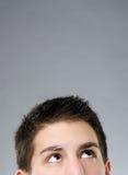 Молодой человек смотря вверх Стоковые Фотографии RF