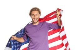 Молодой человек с американским флагом стоковое изображение