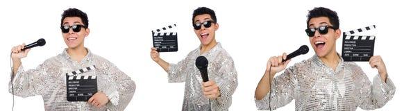 Молодой человек с микрофоном и clapperboard изолированный на белизне Стоковые Изображения