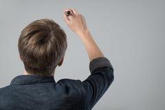 Молодой человек с ручкой Стоковые Изображения