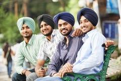 Молодые взрослые индийские сикхские люди стоковая фотография rf