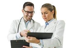 Молодые доктора с цифровой таблеткой Стоковые Изображения RF
