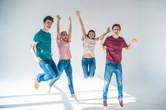 Молодые люди скача совместно Стоковая Фотография